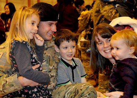 Corporal Carl Richardson with his wife and children