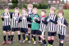 Dunnington Primary School football team celebrate after being crowned North Yorkshire ESFA champions, and also qualifying for the North of England ESFA Finals next month