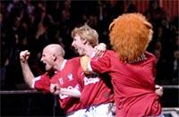 Martyn Woolford (centre) celebrates his winning goal in front of the David Longhurst Stand with team-mate Steve Bowey and club mascot Yorkie the Lion