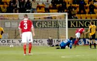 Clayton Donaldson (second from right) wheels away in triumph after bagging the first goal in his hat-trick