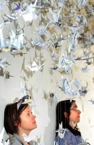 Laura Howarth and Helen Grainger under the origami grotto as part of the exhibition
