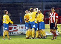 Two-goal marksman Martyn Woolford is mobbed by his York City team-mates