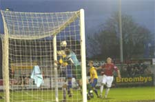 York City goalkeeper Tom Evans flails despairingly at a Michael Twiss corner