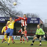 Former City striker Joe O'Neill clears for Altrincham as York's Darren Kelly rises