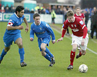 City goalscorer Martyn Woolford runs the Farsley Celtic defence ragged