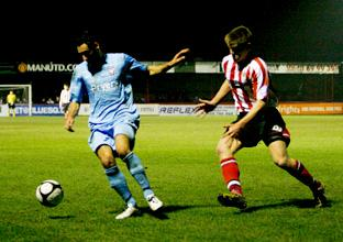 York's Danny Racchi holds off an Altrincham defender