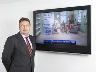 Stuart Paver, managing director of Pavers by a television showing the firm's shopping channel