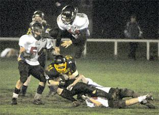 York Centurions player Nick Walter is brought down by a Manchester player