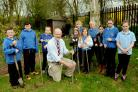 Chairman of governors Dr Roger Pierce and pupils from Derwent Junior School plant aspen trees in the garden area