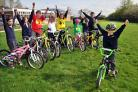 Adam Walsh celebrates with pupils at Skelton Primary School after the school won the York Big Pedal