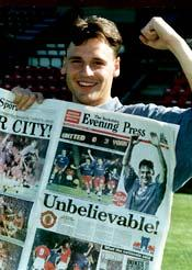 Two-goal Paul Barnes with a copy of the special edition of the Evening Press the day after the amazing 3-0 triumph at Old Trafford