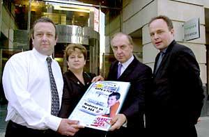Colin and Chris Sanders (left) present the dossier to David Jamieson at Westminster, watched by Selby MP John Grogan