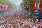 Crowds of well-wishers are led down The Mall, London, towards Buckingham Palace, following the royal      wedding at Westminster Abbey