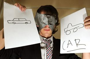 Chris Rawlins during his performance in which a member of the audience made a drawing (in this case a car on the left) and Chris, with his eyes covered with tape, drew what he thought was on the audience member's pad, right