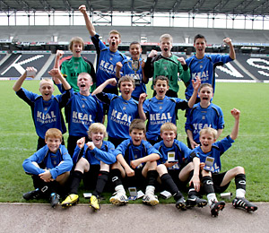 York's Under-13s footballers yell their approval at  becoming the first team from the city to attain English Schools' final  success. Picture: RWT Photography. www.rwt-photography.co.uk