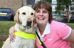 Kelly Cronin with her guide dog, Holly