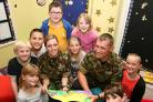 Corporal Chris Taylor and Lance Corporal Sam Thomas read stories to Year 6 pupils at Tang Hall Primary School, York
