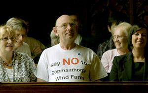 A man makes his point by wearing an anti wind farm campaign t-shirt, in the public gallery during the planning   meeting at the Guildhall in York