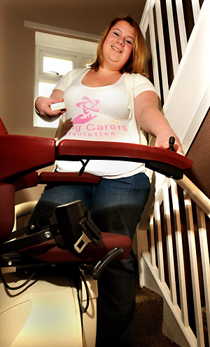 Carer Samantha Richardson opertates a chair lift. Samantha met the Prime Minister in Downing Street
