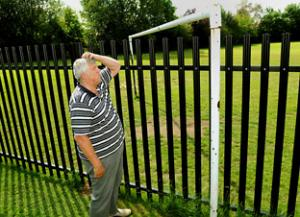 fence through football pitch