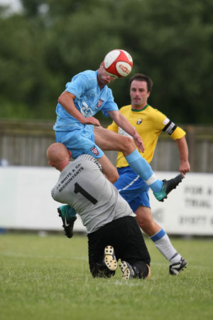 York City's Matty Blair beats the onrushing Garforth goalkeeper to get in a brave header. Picture: Gordon Clayton