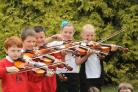 Pupils of New Earswick Primary School, York, with some of the instruments bought in memory of their         former head teacher Herbert Sherriff