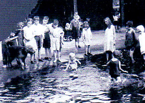 York Press: Youngsters having fun in the park pool in about 1933