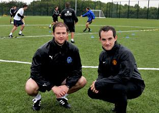 Pickering manager Pete Vasey, left, with his players training at Malton Sports Centre, assisted by Manchester United goalkeeping coach Jack Robinson, right