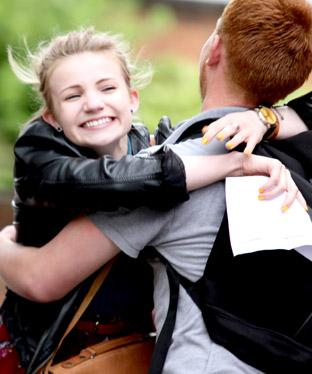 All Saints pupils congratulate each other on their GCSE results.