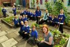 Helen Green, front, from York Cares, with pupils from Westfield Primary School and head teacher Tracey Ralph who want to create a community garden at the school