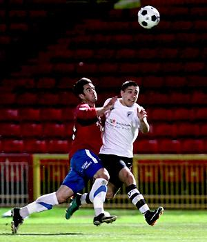 York City's Jon Challinor  tussles with a Gateshead opponent for possession