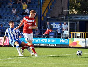 Striker Jason Walker slots in York City's  second goal against Stockport County. Picture: Gordon Clayton