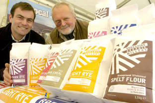 Matt Trevelyan, left, and Joe Coughlan, with Yorkshire Organic Millers products on the local producers' stand, during the York Food and Drink Festival
