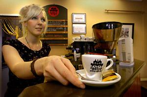 Sarah Shipley serves an espresso at The Attic