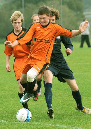 Poppleton goalscorer Josh Shepherd speeds clear of the Pikes defence