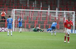 York City centre-back David McGurk sinks to the turf in despair, fourth from left, after  turning Andy Morrell's cross past 'keeper Michael Ingham to hand Wrexham a 2-1  victory in the fourth qualifying round of the FA Cup. Picture: Gordon Clayton