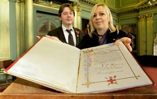 Mansion House manager Richard Pollitt and Coun Julie Gunnell with the copy of Joseph Rowntree's Freedom Of The City scroll