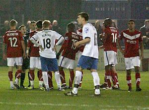 Referee Karl Evans opts to send off  York City's Andre Boucaud after the melee in the  wake of the dismissal of team-mate Jason Walker at Barrow. Picture: Gordon Clayton
