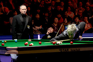 "Ding Junhui, ""not interested"" in the UK Championship's shorter format, looks on from his seat as opponent Neil Robertson puts more points on the board. Picture: Daniel J Roche"