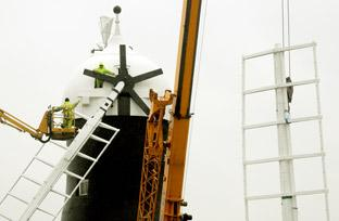 The second sail is craned into position at Holgate Windmill