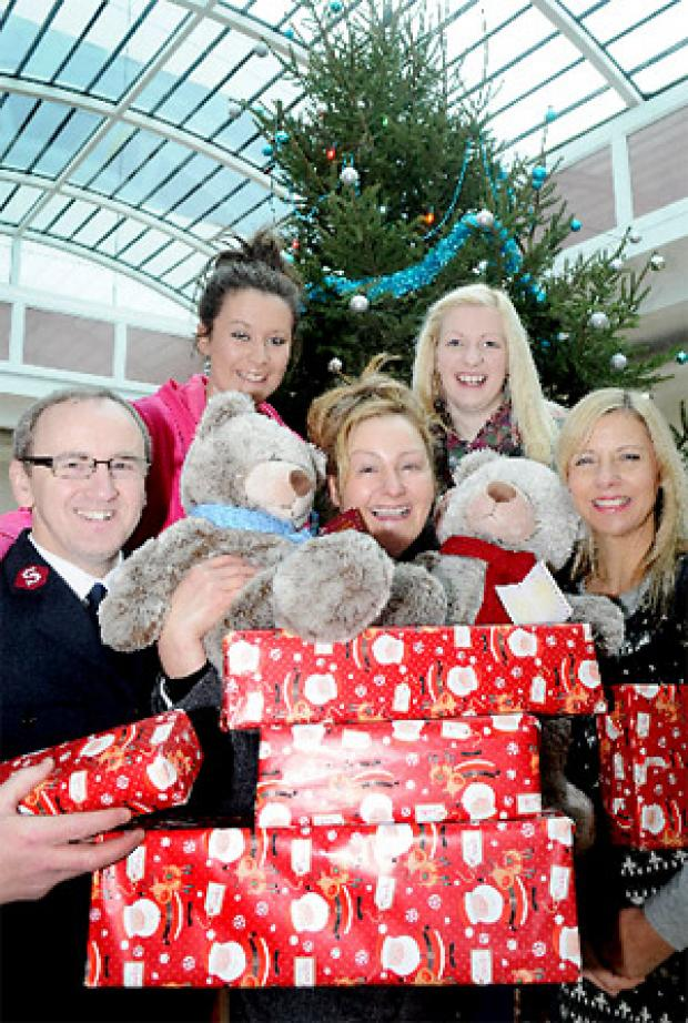 Collecting gifts at Monks Cross are, from left, Andrew Dunkinson, of the Salvation Army, Katherine Sharp, centre manager, Sarah Pierotti, of the women's refuge and back row, carers, Celine Kilvington and Liz Langwade