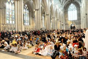 The Nave of York Minster is packed for the Nativity tableau, believed to be the biggest  unrehearsed festive tableau in the world