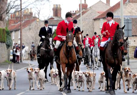 Members of the Middleton Hunt ride through Old Malton on Boxing Day.