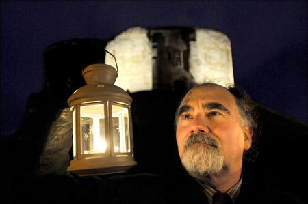 Jerry Karlin, a member of York's Jewish community, holds a lantern in front of Clifford's Tower during a ceremony to mark Holocaust Memorial Day.