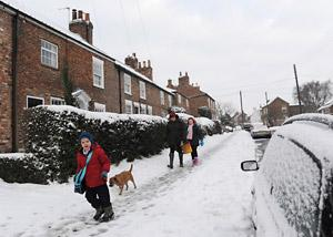 Residents battle through snow in Dunnington