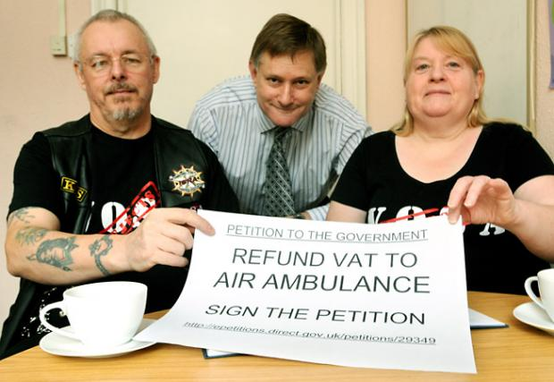 York Central MP Hugh Bayley, centre, with Ken and Helen Sharpe and their e-petition