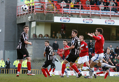 York City midfielder Scott Kerr, centre, watches his header into the net to seal a 1-0 FA Trophy win at Grimsby – ending a personal goal drought lasting 121 games.  Picture: Gordon Clayton