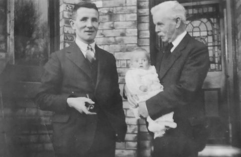 Robert Duncan De Little, founder of the family firm, holding his baby grandson, Robert James (now known as Jim), in 1935. Jim's father, Robert Geoffrey, is on the left
