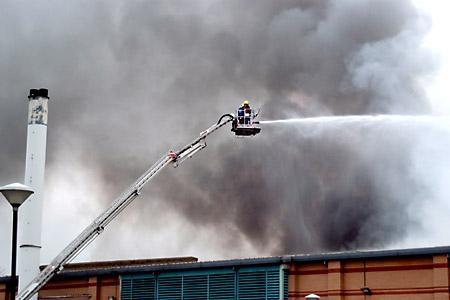 A firefighter tries to quell the flames as fire ripped through Selby's Abbey Leisure Centre.
