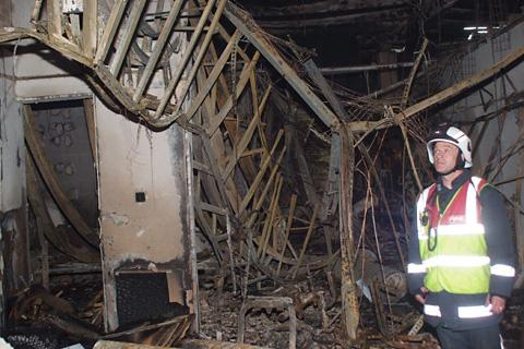 York Press: A firefighter inspects some internal damage  at  Abbey Leisure Centre in Selby